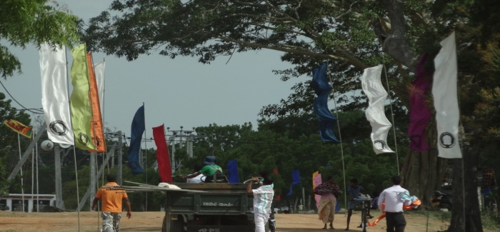 Maheweli Authority and NHDA banners are being taken down by government staff.